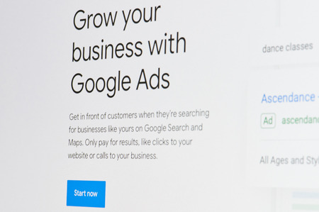 New york, USA - april 8, 2019: Grow business with google ads on digital screen macro close up view