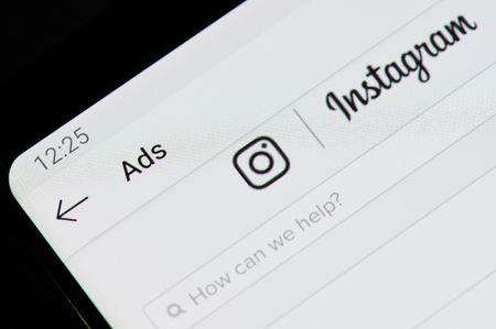 New york, USA - april 8, 2019: Create instagram ads application on digital screen macro close up view