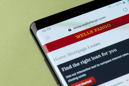 New york, USA - april 22, 2019: Wells fargo home mortgage loans interface on smartphone screen