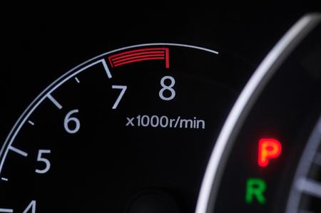 Rpm car tachometer close up view in dashboard Stock Photo