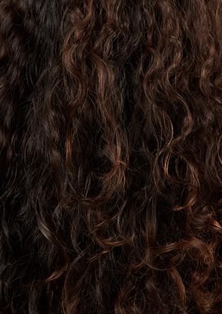 Brown curly hair closeup. Latina brownish curls details 스톡 콘텐츠