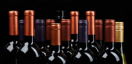 Many wine bottles heads isoalted on black background