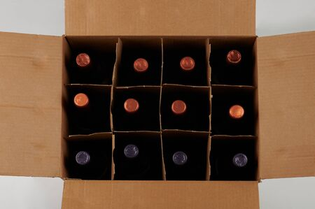 Wine bottles in open case above top view Banque d'images