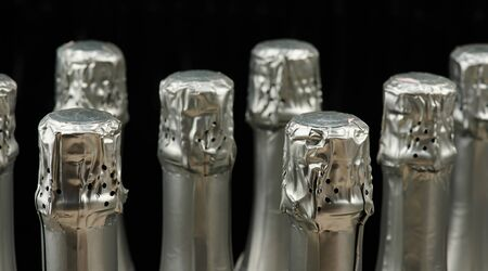 Silver champagne wine bottles close up isolated Archivio Fotografico - 124625610