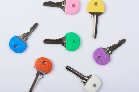 Keys from different doors with colorful handle for memory Reklamní fotografie