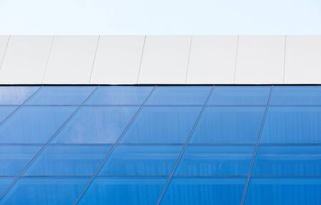 Roof of business center with glass window wall