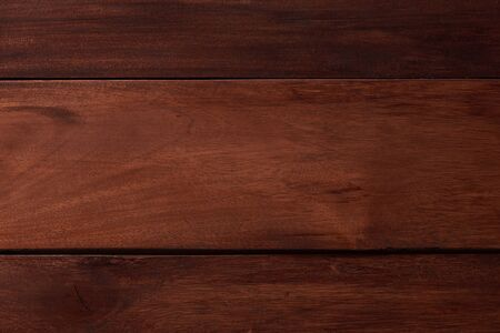 Dark finished pine background close up view. Pine planks