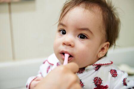 Baby brushing teeth before go sleep. Portrait of little kid with toothbrush