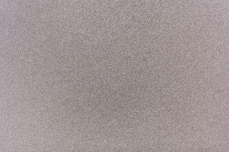 Grey matte metal background macro close up view