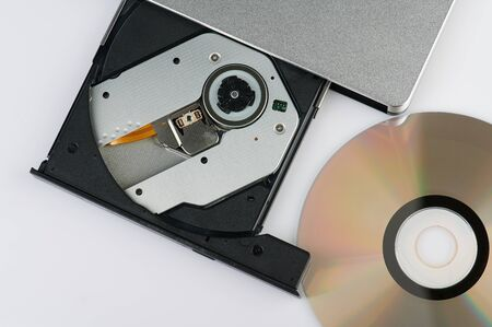 Burn cd theme. External dvd reader with cd isolated Stock Photo