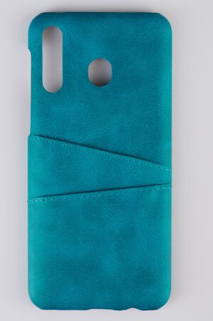 Green leather smartphone case isolated close up view