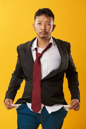Young asian man with no money in his pockets Stock Photo