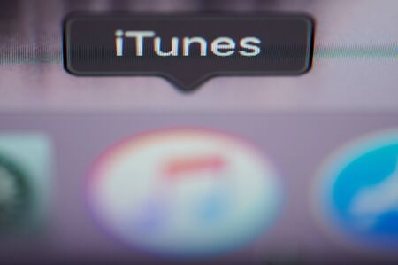 New york, USA - july 26, 2019: Selecting itunes application on computer macro close up view in pixel screen