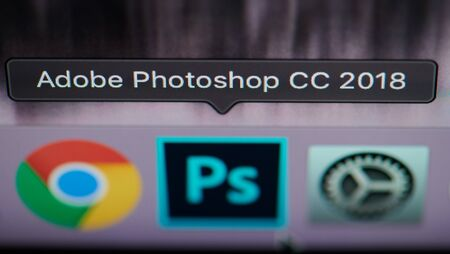 New york, USA - july 26, 2019: Selecting photoshop application on computer macro close up view in pixel screen