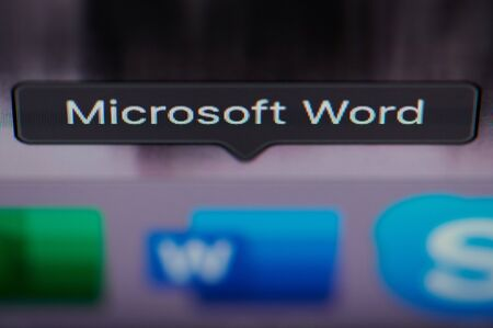 New york, USA - july 26, 2019: Selecting microsoft word application on computer macro close up view in pixel screen