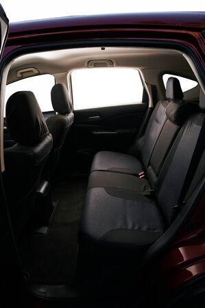 Interior of modern SUV car with back black seats isolated