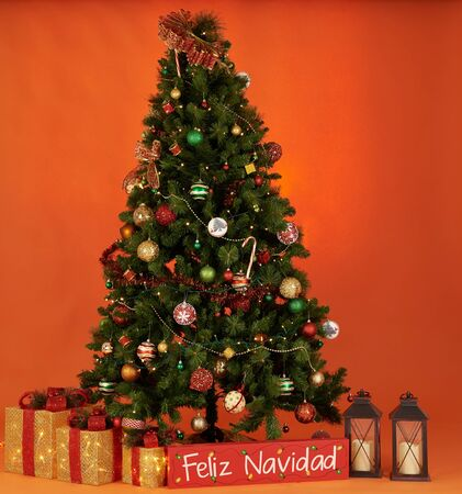 Colorful christmas tree on orange color background