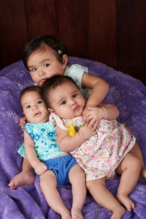 Group of small funny babies watching in camera