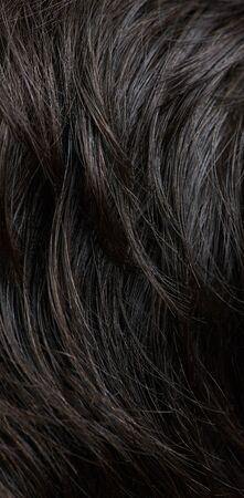 Real dark brown human hair background close up view