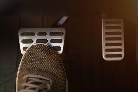 Pressing break car pedal with shoe close up view Banco de Imagens