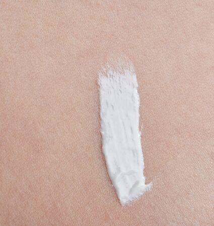 White cream stroke on skin texture background macro close up view 写真素材