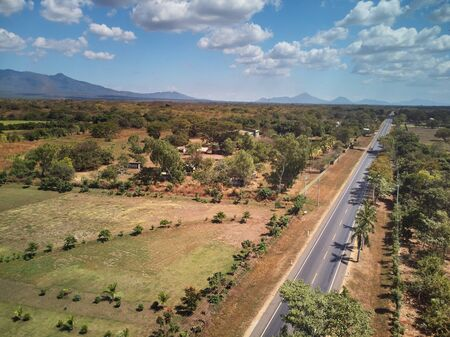 Road on natural background aerial drone above view