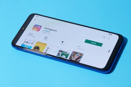 New york, USA - september 28, 2019:Installing mobile instagram app on smartphone screen close up view