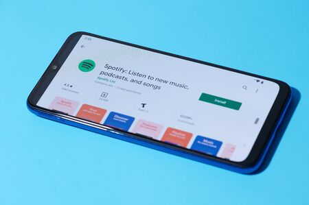 New york, USA - september 28, 2019:Installing mobile spotify music on smartphone screen close up view Redactioneel