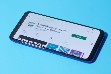 New york, USA - september 28, 2019:Installing mobile amazon app on smartphone screen close up view