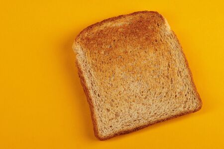 One bread toast close up view isolated on yellow background