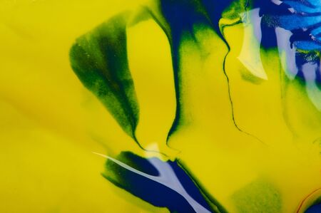 Abstract yellow background with blue and green swirls Stockfoto