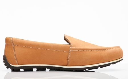 Brown loafer shoe side view isolated on white background 스톡 콘텐츠