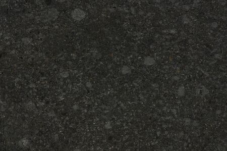 Black stone brushed texture surface macro close up view