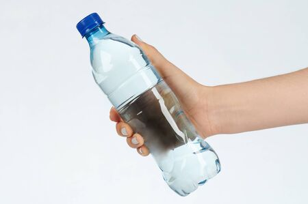 Woman hold plastic bottle with water close up Stockfoto