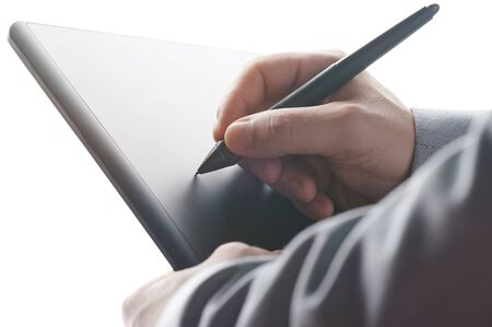 Putting electronical signature with tablet close up view