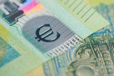 Macro of euro money sign on green new banknote