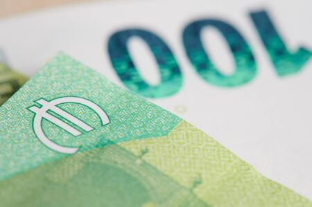 Euro sign on banknote of 100 close up view