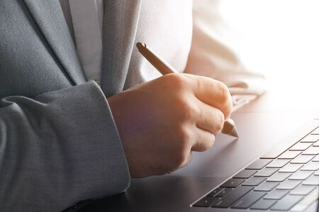 Signing document online theme. Man hand with pen write on touch pad