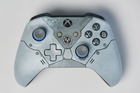 New-York , USA - February 11, 2020: Grey gaming xbox controller isolated on white background Éditoriale