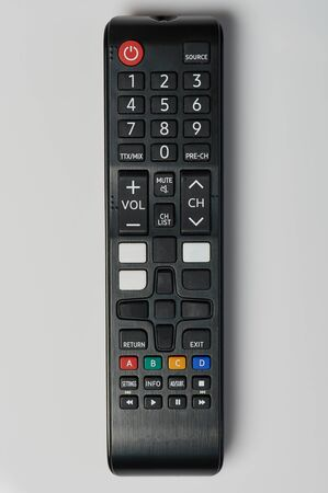 Black tv remote control close up view isolated on white background Standard-Bild