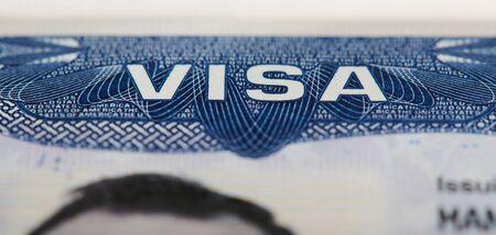 Macro of Usa visa stamp in passport. Travel to america theme Stock fotó