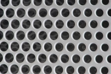 Pattern of vent holes. White plastic mesh barrier