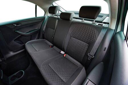 Clean textile dark grey car backseat above top view