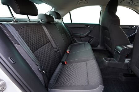 Clean modern car back seats side view isolated
