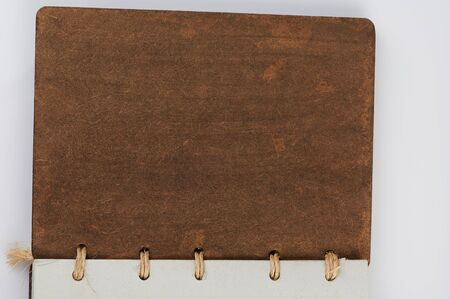 Leather old book brown cover join with rope isolated