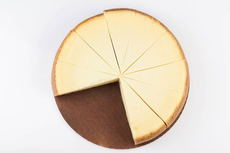 Simple sliced cheescake above top view isolated