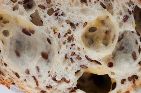 Texture of white bread with seeds macro close up view 스톡 콘텐츠