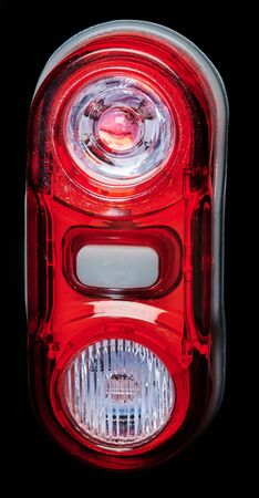 Red rear bicycle lamp with button isolated close up view Standard-Bild