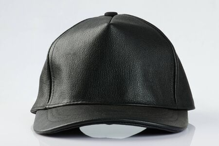 Close up of black leather hat isolated on studio background
