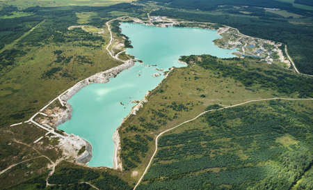 Green water in mine pit aerial above top view
